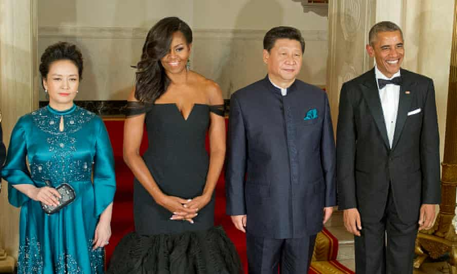 China's President Xi Jinping and his wife, Peng Liyuan, pose with US first lady Michelle Obama and President Barack Obama at a state dinner in the White House in September 2015.