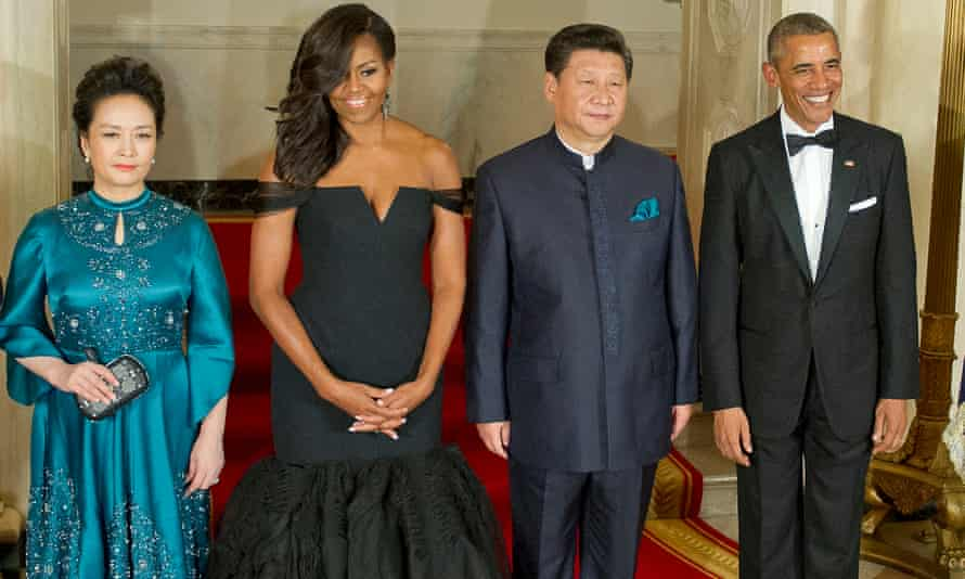 Xi Jinping and Barack Obama, pictured with their wives Peng Liyuan and Michelle Obama.