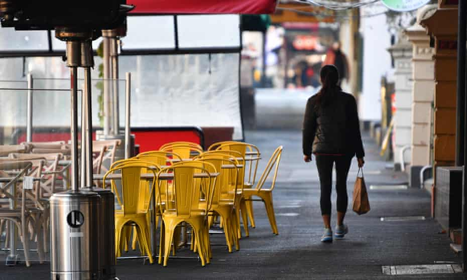 Restaurant furniture is seen left outside of a business along Lygon Street in Melbourne