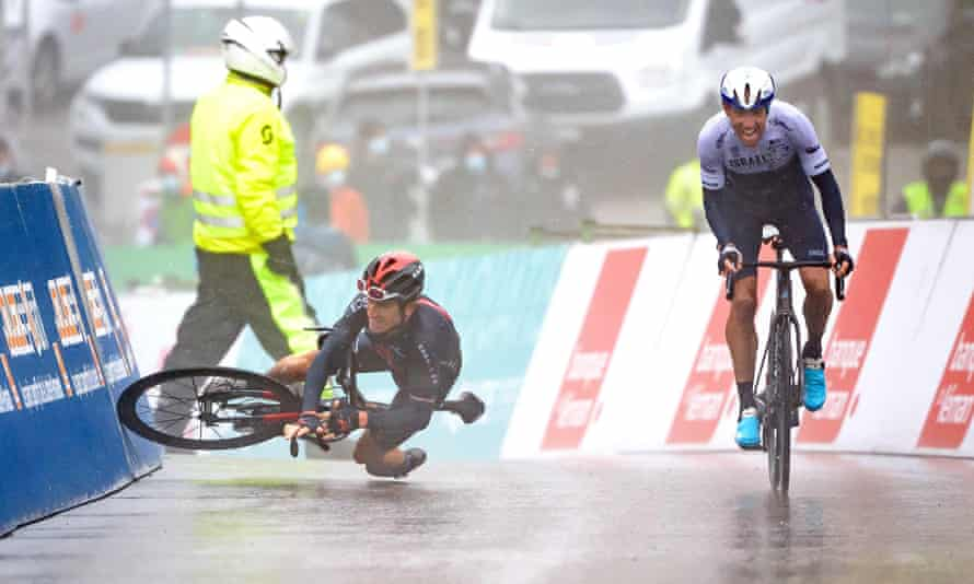 Geraint Thomas falls next to Michael Woods within metres of the finish line