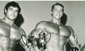 Italian bodybuilder Franco Columbu, who has died aged 78, on a podium with Arnold Schwarzenegger.