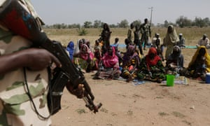 Soldiers guard Nigerians fleeing Boko Haram