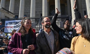 Supporters greet Cédric Herrou, centre, outside Lyon's courthouse in March.