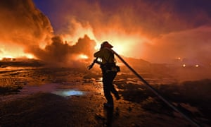A firefighter battles a wildfire in California last week.