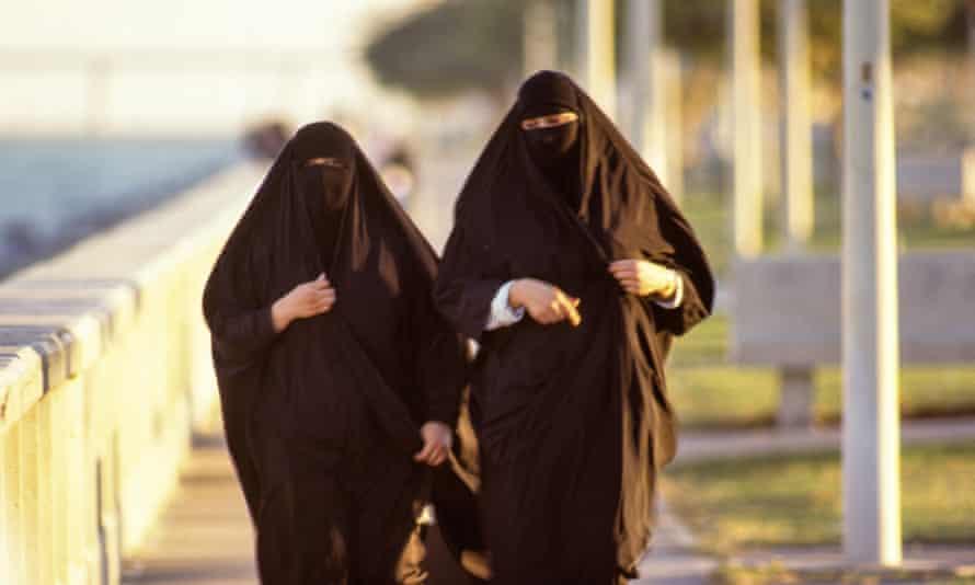 Women stroll along the corniche in Al Khobar, Saudi Arabia.