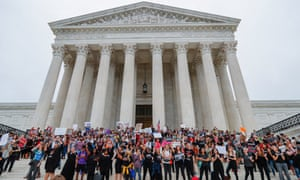 Protesters crowd on the steps outside the US supreme court
