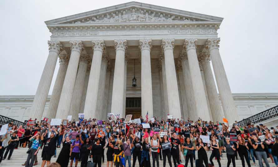 Protesters on the steps outside the supreme court, after the Senate voted to confirm Brett Kavanaugh.