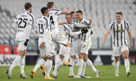 Cristiano Ronaldo celebrates with teammates after scoring Juventus's second goal against Cagliari
