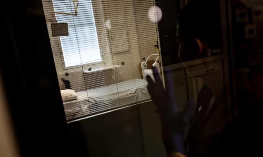 A nurse outside a hospital room