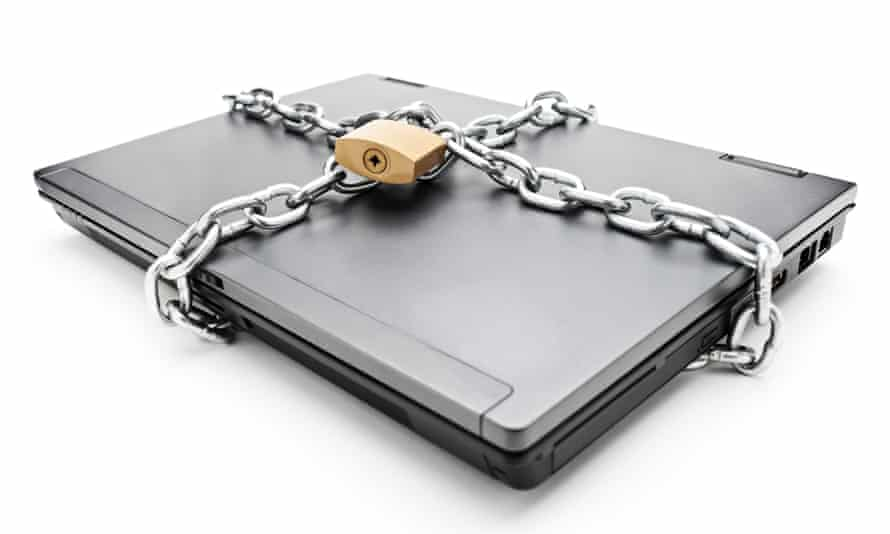 A laptop padlocked.