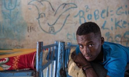 A teenage boy in a dormitory for unaccompanied minors in Shagrab camp, Sudan