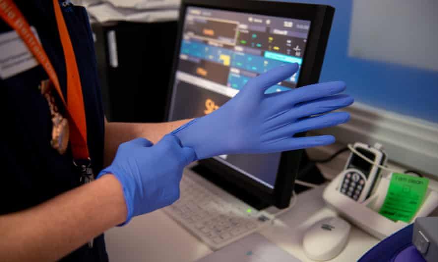 health worker putting on gloves