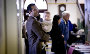 George P Bush with son Prescott, turns out for a primary election in Fort Worth, Texas, in March 2014.