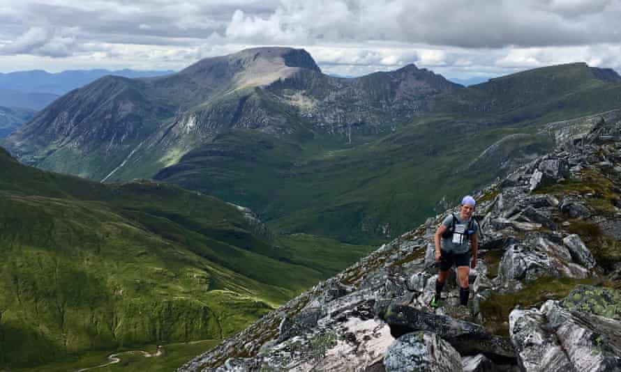 Heather running in the Mamores with Ben Nevis in the distance.