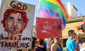 Participants hold signs during the second Cyprus Pride parade in central Nicosia, Cyprus, 06 June 2015