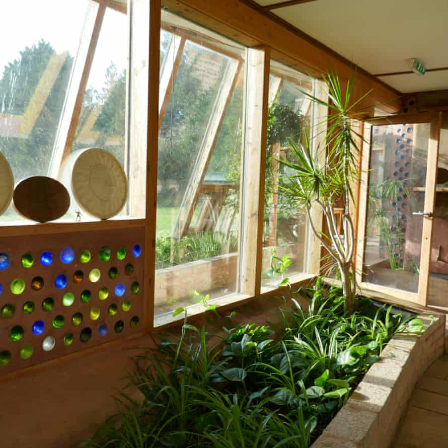 Interior showing plants and artwork at Earthship Brighton, UK.