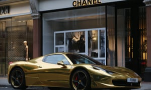 A gold Ferrari at a Chanel store. The super-rich surveyed had an average of £1.1bn.