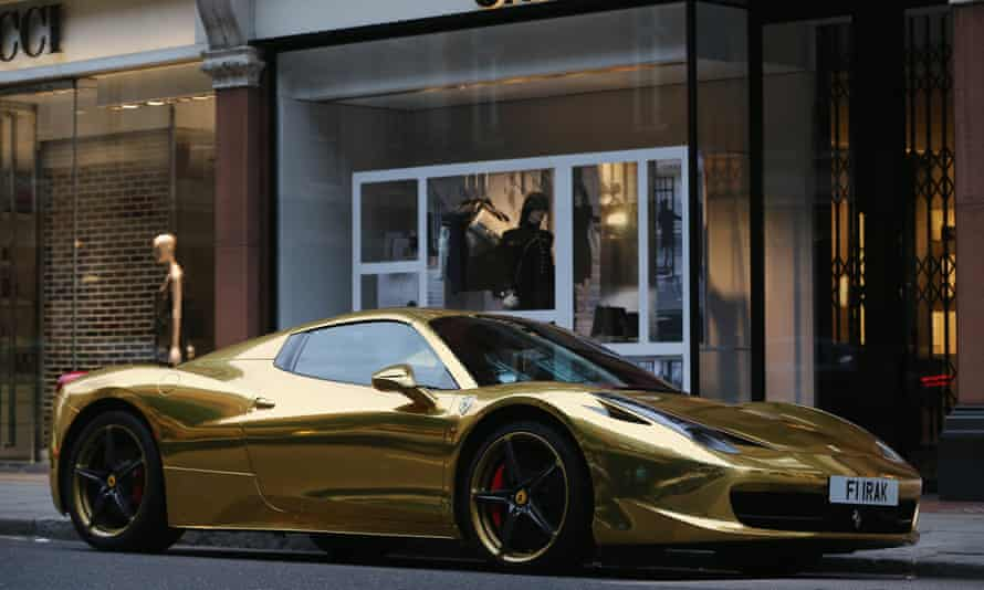 A gold Ferrari parked in Sloane Street in London.