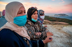 Fnideq, MoroccoCross-border workers look out from their terrace to the Spanish enclave of Ceuta after six months of deprived livelihood because of border closures