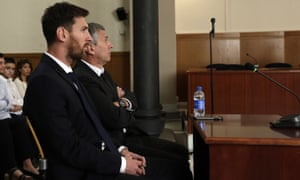 Lionel Messi and his father Jorge Horacio Messi sit in court.
