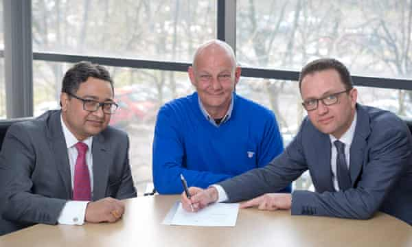 (From left) Bimlendra Jha, chief executive of Tata Steel UK, Paul McBean, chairman of the Scunthorpe works' multi-union committee, and Marc Meyohas, partner at Greybull Capital.