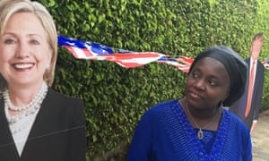 Matel Bocoum, a journalist for Senegal's Le Soleil Business, looks at a cardboard cutout of United States Democratic presidential candidate Hillary Clinton at the U.S. Ambassador's residence in Dakar, Senegal, on Tuesday.