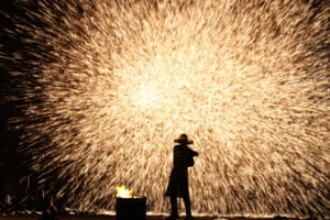 Hengyang, China A folk artist performs with molten iron