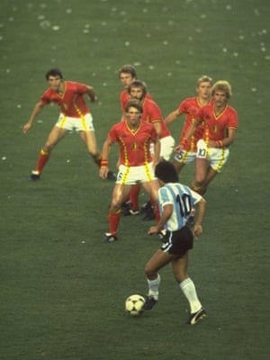 Maradona, in his famous number 10 shirt, is confronted by a posse of Belgium defenders during the 1982 Wold Cup in Spain