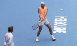 Spain's Rafael Nadal makes a backhand on Sunday as coach Francis Roig watches during practice session ahead of the Australian Open in Melbourne.