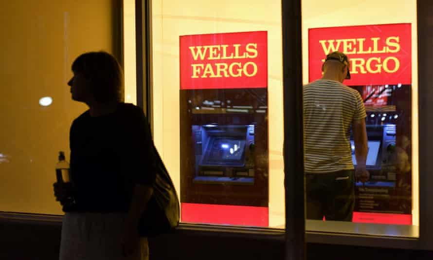 A customer uses a Wells Fargo bank ATM