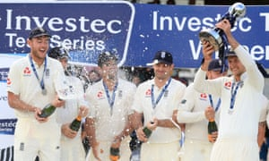 Joe Root lifts the trophy after England won the series on day three of the third Test match against West Indies at Lord's.