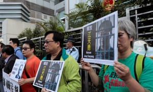 Pro-democracy demonstrators demand the release of mainland Christian rights lawyer Jiang Tianyong in a protest in Hong Kong on Friday.