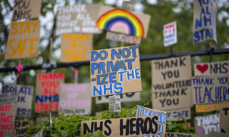 Signs in support of the NHS are seen in East London.