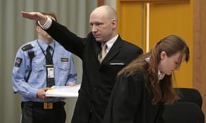 Anders Behring Breivik gestures as he enters a courtroom on Tuesday, March 15.
