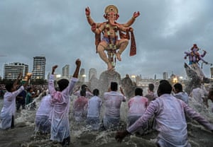 Mumbai, India Hindus carry idols of the elephant-headed god Lord Ganesha into the Arabian Sea, one of the rituals of the Ganpati festival