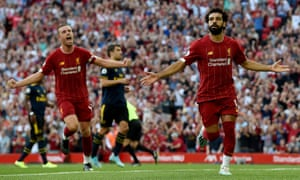 Mohamed Salah celebrates after scoring.