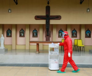 A healthcare worker at a Catholic church training centre turned into a self-isolation shelter for patients with coronavirus, in Jakarta, Indonesia.