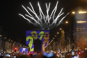 A firework explodes over the Arc de Triomphe as part of the New Year celebrations on the Champs Elysees, in Paris, France,