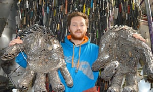 Sculptor Alfie Bradley with artwork made from weapons collected after police knife amnesties