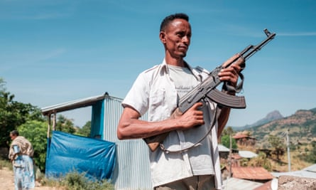 A militiaman poses for a photograph in the town of Musebamb in Amhara province