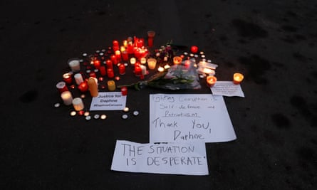 Candles are lit in memory of Malta's Daphne Caruana Galizia in Brussels, Belgium on Wednesday.