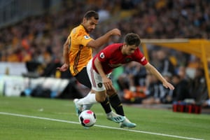 Daniel James is challenged by Jonny Otto.