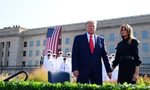 Donald and Melania Trump hold hands in front of the Pentagon during the 18th anniversary commemoration ceremony of the September 11 terrorist attacks, in Arlington, Virginia.
