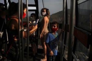 People stand inside a cable car as they visit Sugarloaf Mountain during the reopening, after a months-long closure due to the coronavirus outbreak, in Rio de Janeiro, Brazil, on 15 August, 2020.