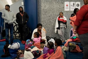 Evacuees shelter in the George R Brown convention center.