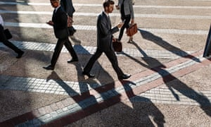 Business people walking to office in the morning on a busy street