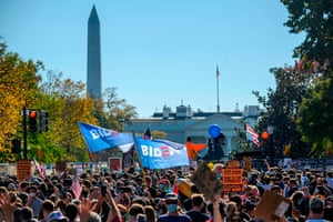 People celebrate on Black Lives Matter plaza across from the White House in Washington, DC on November 7, 2020, after Joe Biden was declared the winner of the 2020 presidential election