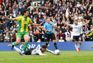 Derby County's Tom Lawrence is brought down