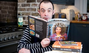 Guardian journalist Alexis Petridis reads musician's celebrity cookbooks at home. Food around him is: Two minute tomato sauce receipe with pasta from Fuck That's Delicious cookbook by rapper Action Bronson, Butternut Squash soup from My Life On A Plate by Kelis and Black bean quesadilla and salsa receipe from Pleasures, Meals of an Album, by Adrienne Amato and Leslie Feist. 24 January 2018