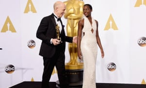 J.K. Simmons, winner of best actor in a supporting role for Whiplash heads into the press room with Lupita Nyong'o